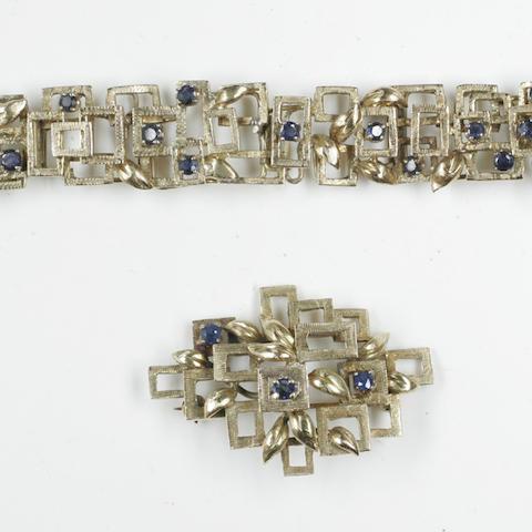 A sapphire set bracelet and brooch suite