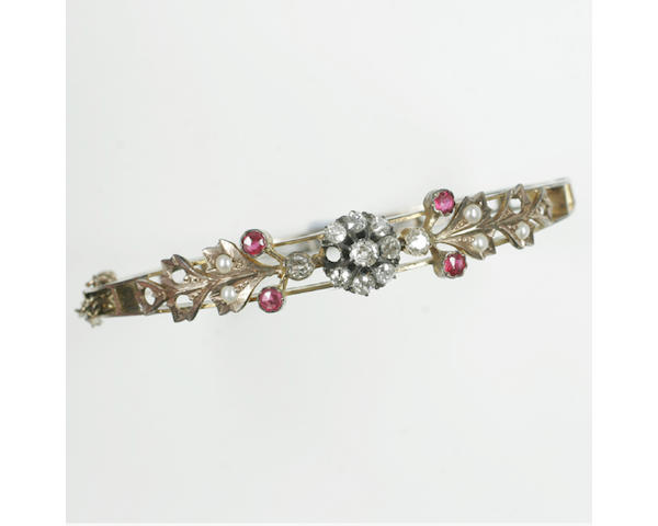 A Victorian gem set hinged bangle,