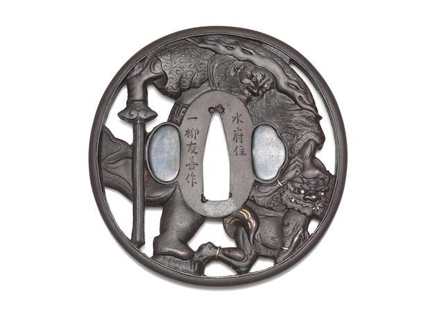 An iron tsuba By Ichiryu Tomoyoshi, late Edo/Meiji Period