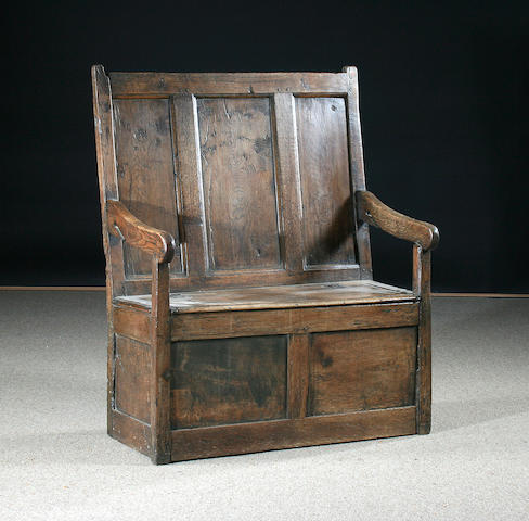 A mid 18th Century oak settle, of small proportions