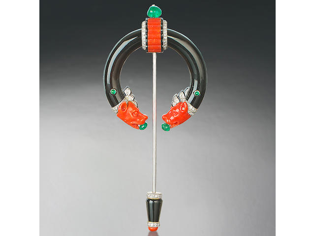 An onyx, coral, diamond and emerald penannular brooch, by Cartier,