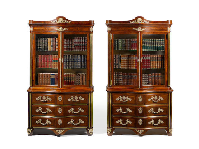 An important pair of Victorian Exhibition model kingwood crossbanded and parquetry serpentine Bookcase/Commodes by Gillows