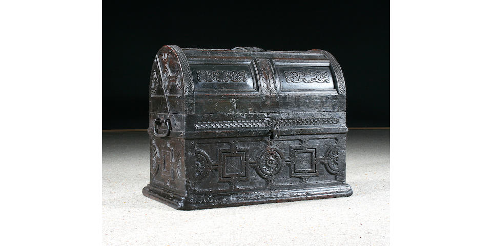 An unusual early 17th Century oak dome lidded chest
