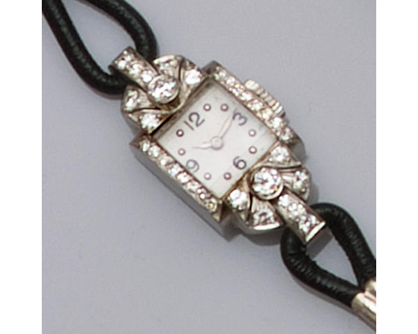 International Watch Company: A lady's diamond set cocktail watch