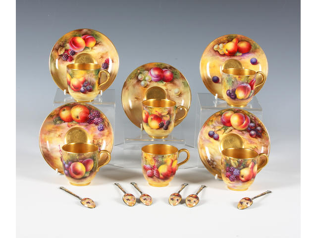A Royal Worcester fruit painted boxed part coffee set with matching spoons