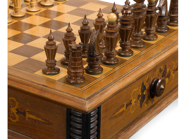 An ornamentally turned walnut chess set,  Austria, 20th century,