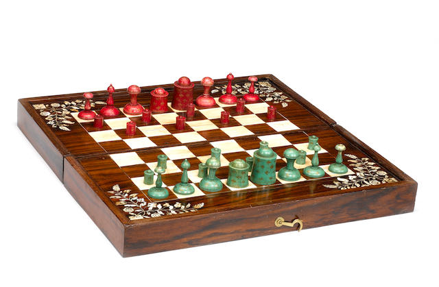An Islamic painted ivory chess set,  Northern India, late 18th/early 19th century,