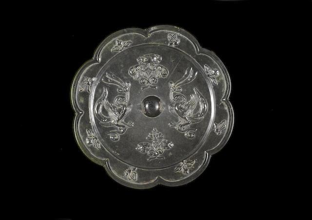 A bronze lobed 'phoenix' mirror Tang Dynasty
