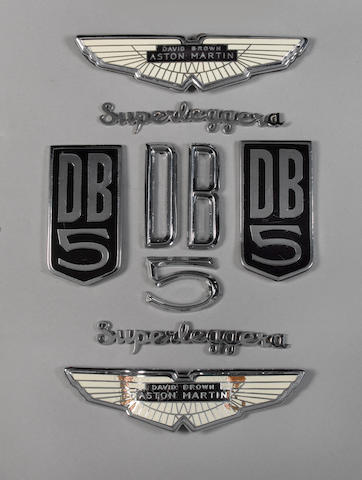 The set of badges and scripts removed from the James Bond 'Goldfinger' Aston Martin DB5,