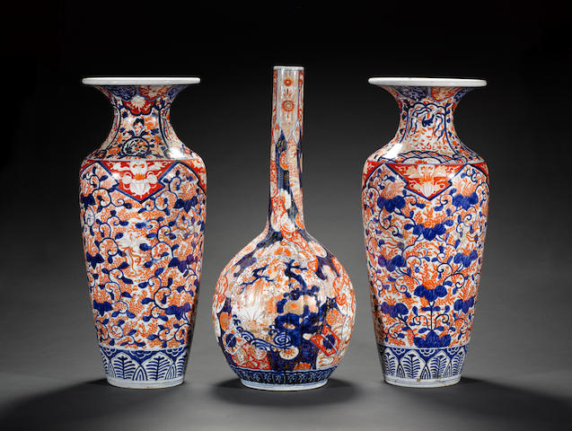 Three Japanese Imari vases, comprising: a pair of slender oviform vases and a bottle vase Meiji Peri