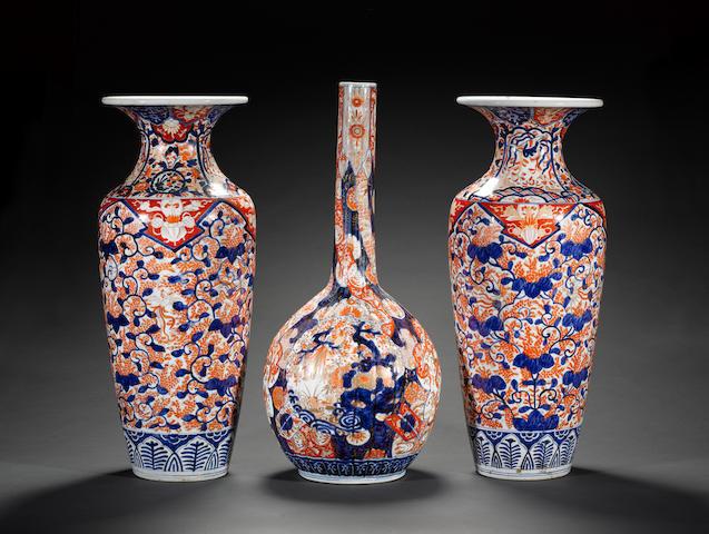 Three Japanese Imari vases, comprising: a pair of slender oviform vases and a bottle vase Meiji Peri