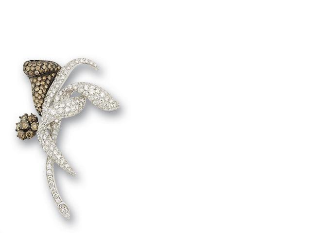 A coloured diamond and diamond brooch