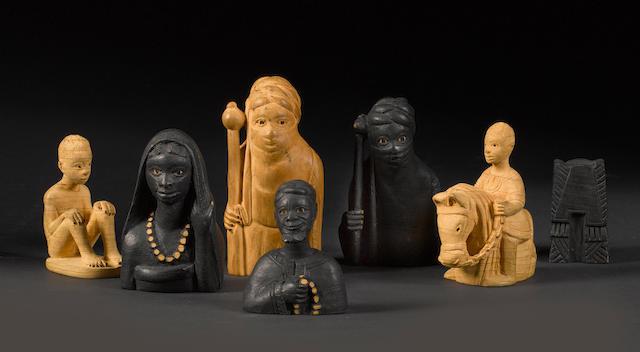 A carved thornwood tribal chess set by J. D. Akeredolu, Lagos, Nigeria, circa 1950,