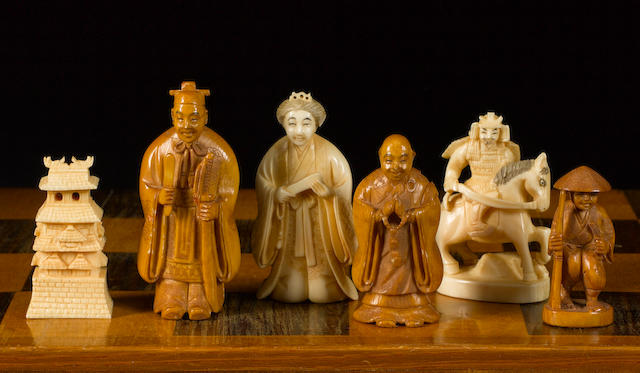A carved ivory netsuke figural chess set, Japan, circa 1950,