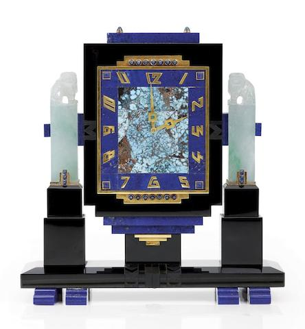 A fine and rare gold, black onyx, jade, lapis-lazuli and turquoise eight-day desk timepiece.  By Vacheron & Constantin. Retailed by Brock & Co, France, Movement No.410240, 1930s