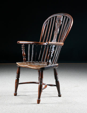 A mid 19th Century yew wood high back Windsor elbow chair