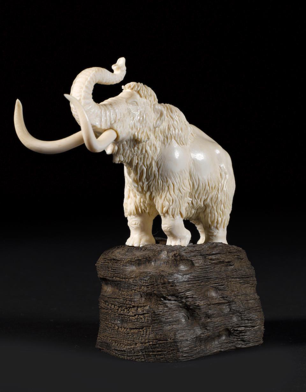 "A mammoth ivory ""animalier"" chess set, Russia, late 20th century, designed by Fiodor Shidlovski, carved by Eugeni Kolesnikov,"
