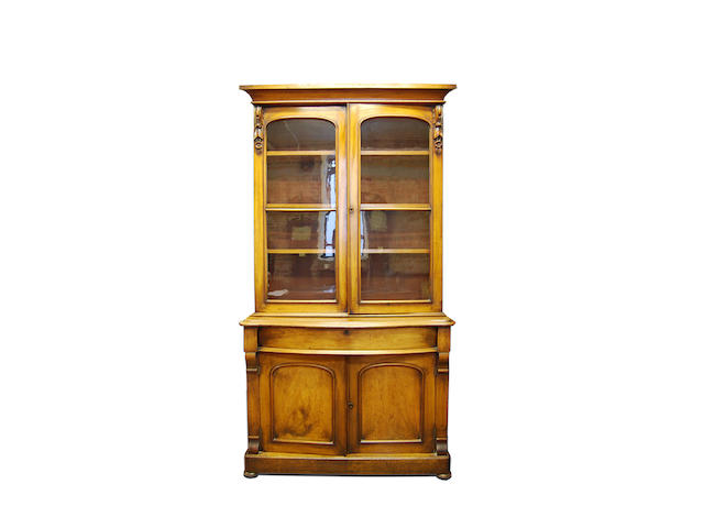 A Victorian mahogany glazed bookcase cupboard