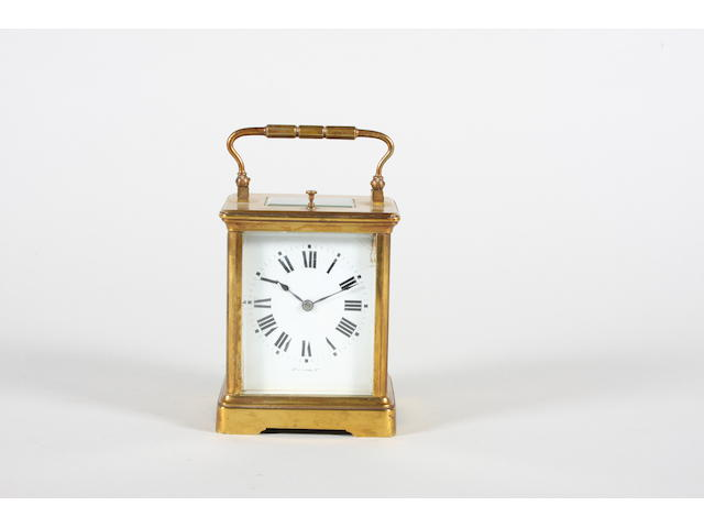 A late 19th century French gilt brass and bevel glass cased repeating carriage clock