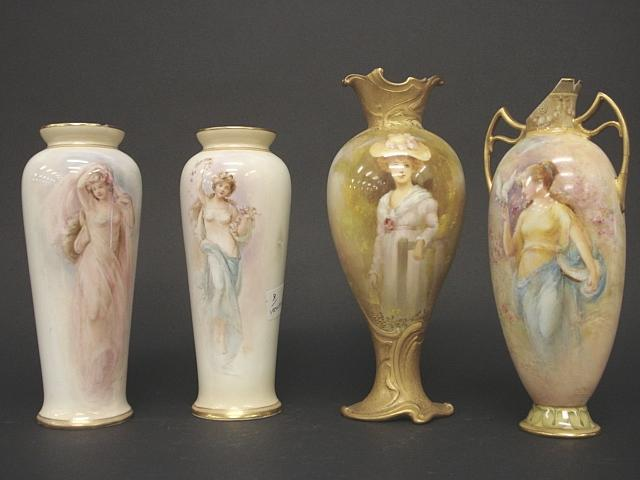 Four Royal Doulton painted vases