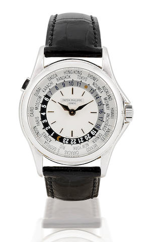 Patek Philippe. A fine and rare 18ct white gold self-winding wristwatch with world time function World Time, Ref 5110G, case no. 5209302, Circa 2000