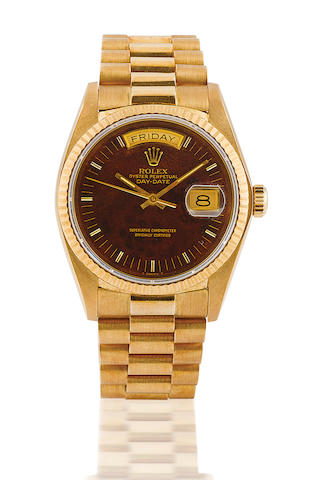 Rolex. A fine 18ct gold automatic wristwatch with day and date , chocolate dial, YG, oyster perpetual Day-date Oyster Perpetual President Day Date, Case No. 7214100, Ref: 18038, Circa 1980's