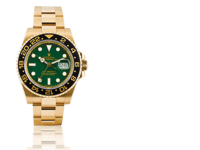 Rolex. A fine 18ct gold automatic dual time zone calendar bracelet wristwatch GMT Master II, Ref: 116718, Case no. D742094, D serial, 2007