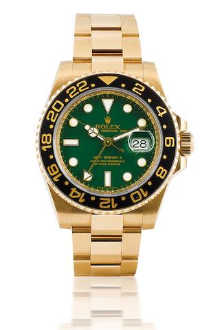 Rolex. A fine 18ct gold automatic dual time zone calendar bracelet wristwatch GMT Master II, Ref: 116718, Case no. D742094, D serial, 2007