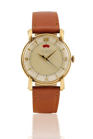 Le Courtre. A gold plated automatic centre second wristwatch with power reserve