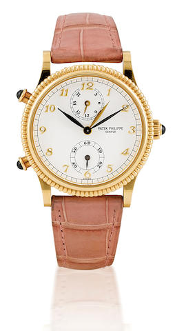 Patek Philippe. A fine and rare 18ct gold ladies manual wind wristwatch with GMTTravel Time, Ref: 4864, Circa 2000's