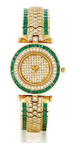 A fine 18ct gold diamond and emerald wristwatch