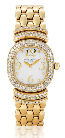 Patek Philippe. A fine 18ct gold quartz diamond wristwatch
