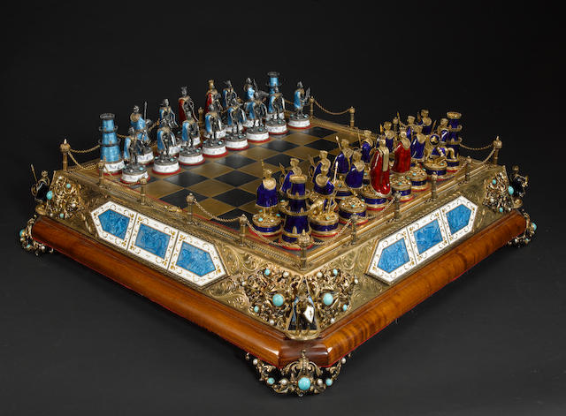 "A ""silver coloured metal"", enamel and gilt figural chess set, Austria, 20th century,"
