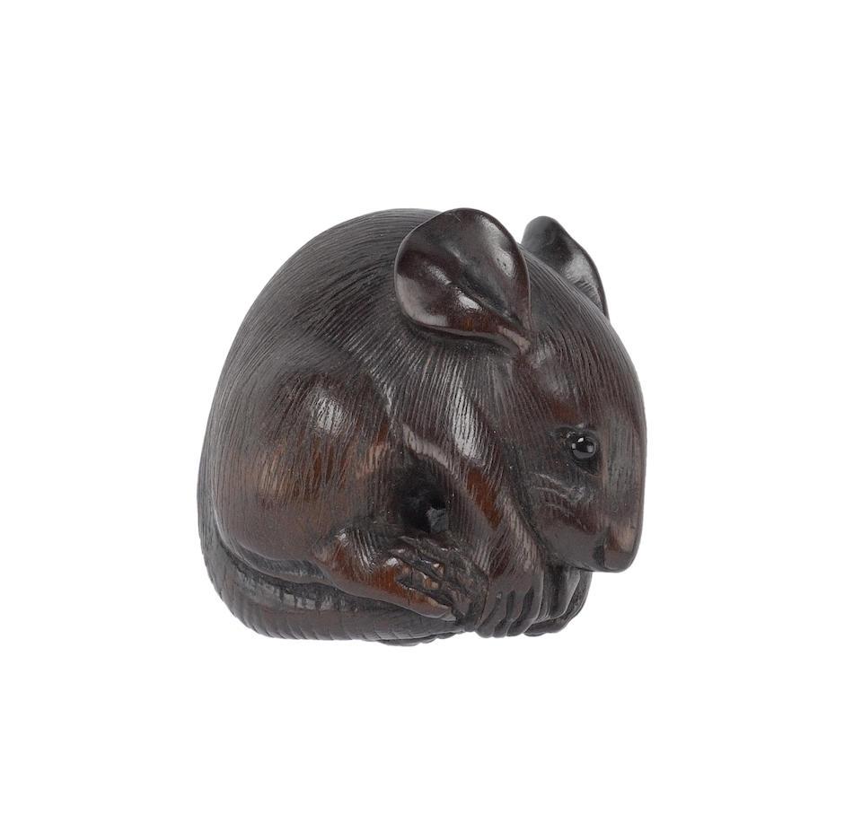Four wood animal netsuke, comprising: