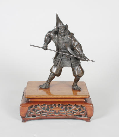 A late 19th century Japanese bronze figure of a warrior in armour