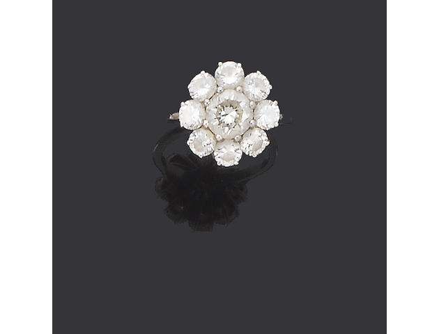 A diamond cluster ring, by Boodle & Dunthorne