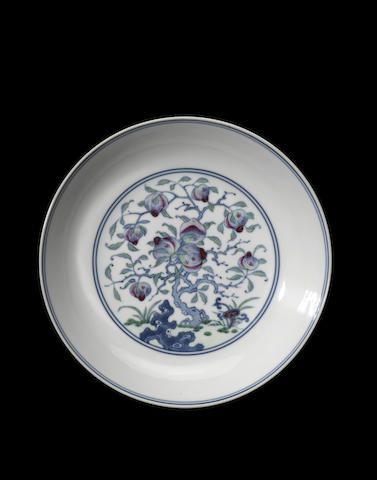 An important pair of famille rose peach dishes Yongzheng six-character marks and of the period
