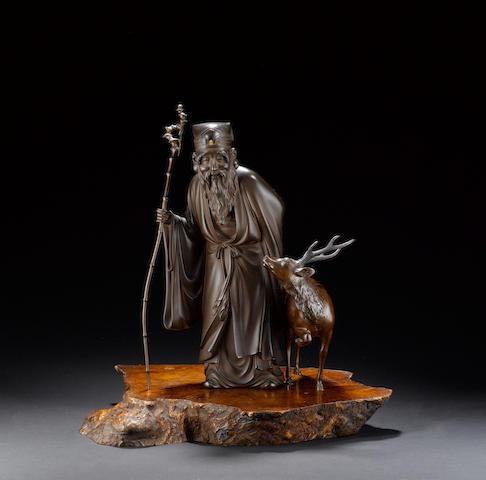 An elegant bronze okimono of Jurojin and his stag;