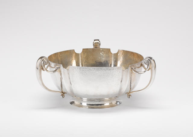 An Edwardian silver three-handled punch / rose bowl, maker's mark Henry Hodson Plante, overstriking that of another probably Plante & Bannister, London 1906, with retail mark H. H. Plante 12 Bury St. S.W., also impressed pattern number 105,