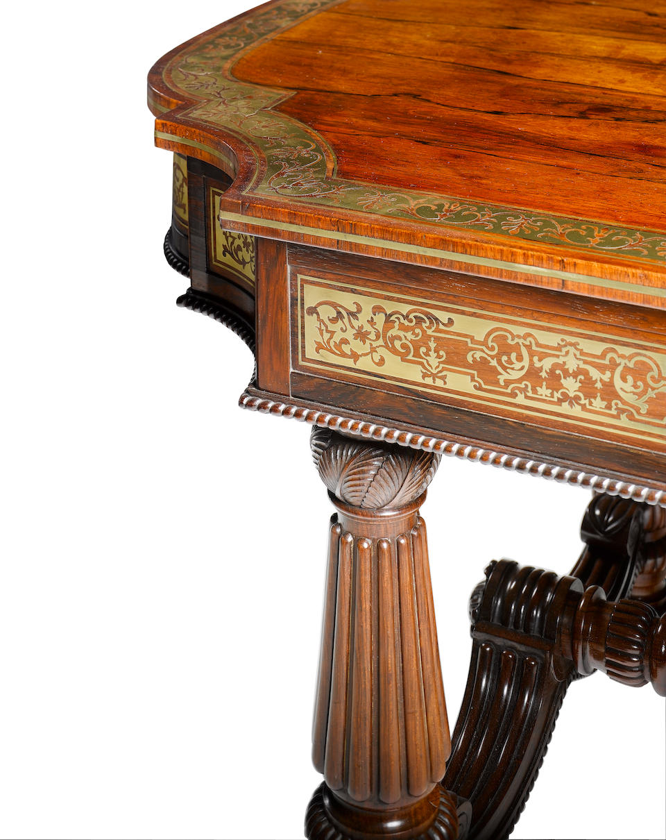 A Regency rosewood and brass marquetry Library Table attributed to Gillows