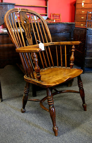 A mid 19th Century yew wood high back Windsor elbow chair,