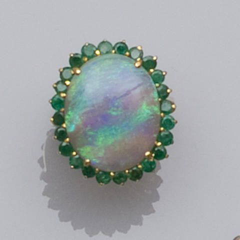 An opal and emerald dress ring