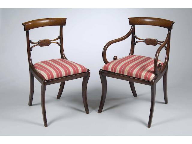 A set of eight late Regency mahogany dining chairs