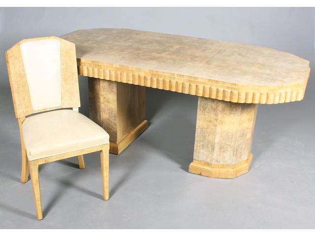 An Art Deco period faded/pale burr and figured walnut ten piece dining room suite