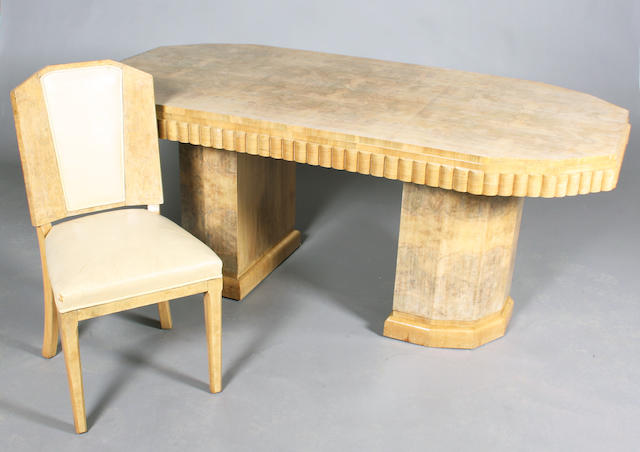 An Art Deco faded/pale burr and figured walnut ten piece dining room suite