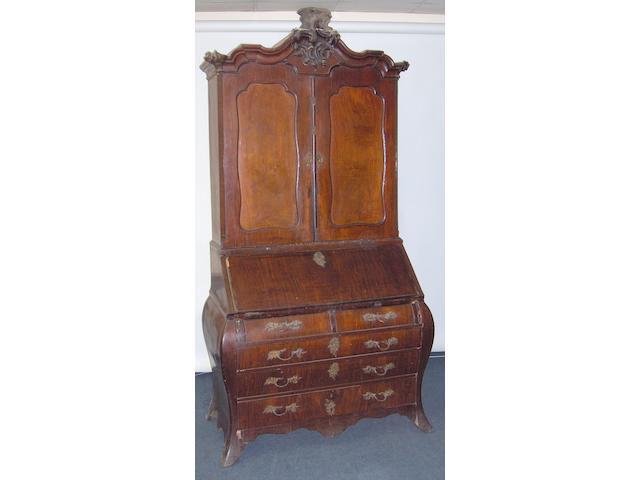 A mid 18th century  mahogany continental   bombe bureau bookcase
