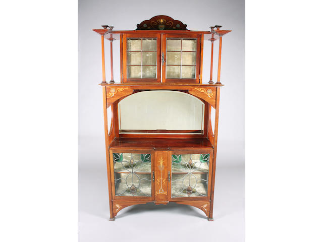 An Art Nouveau inlaid mahogany display cabinet