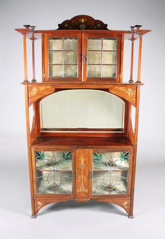 An Art Nouveau inlaid mahogany display cabinet