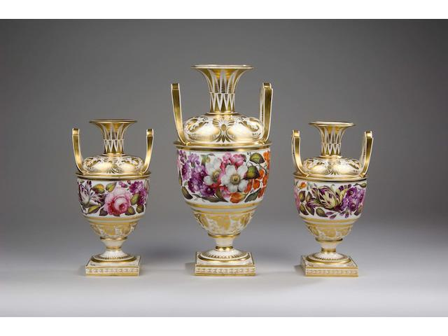 A garniture of three early 19th Century Derby vases
