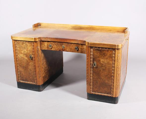 A 1930s continental Art Deco style burr walnut kneehole desk